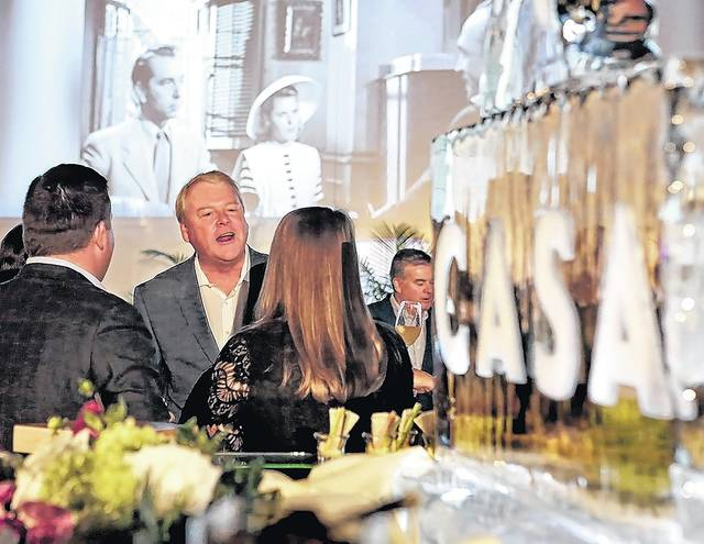 Jack Carr, of Exeter, chats with friends over hors d'oeuvres during 'An Evening in CASAblanca' fundraiser for CASA of Luzerne County in Forty Fort on Thursday. Bill Tarutis | For Times Leader