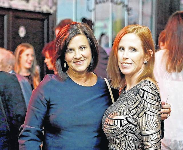 Caroline Youngman, left, and Jen Leung, both of Dallas, pose for a photo at the CASA of Luzerne County fundraiser in Forty Fort on Thursday. Bill Tarutis | For Times Leader