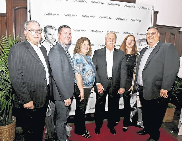 Times Leader Media Group executives attending the CASA of Luzerne County fundraiser, from left: circulation director Tom Salvo, major accounts executive Mike McGinley, advertising manager Diane McGee, publisher Mike Murray, sales and marketing vice president Kerry Miscavage, and production director Jeff Tinner. Bill Tarutis | For Times Leader