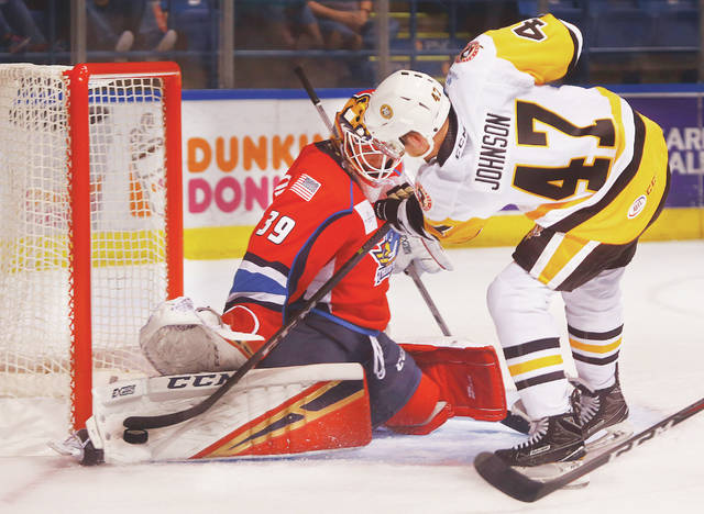 Springfield goalie Michael Hutchinson stretches out the right pad to deny  Penguins winger Adam Johnson. 1ea58dd98