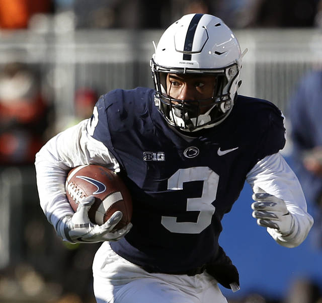 Penn State s DeAndre Thompkins (3) takes off running after a catch against  Wisconsin during the second half of an NCAA college football game in State  ... b510da2b9