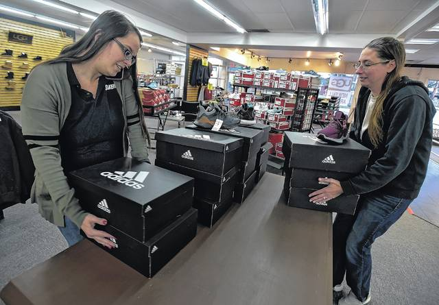 Ann-Marie Neikum and Kolina Ganz prepare for a sale that starts Saturday at  the Jay Dee store in Plains after the announcement of the store s immenent  ... c4a9889e1