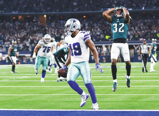 Cowboys wide receiver Amari Cooper scores a 15-yard touchdown to clinch  Sunday  8217 06b8d2126