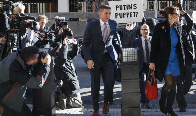 Judge delays sentencing for former Trump adviser Flynn