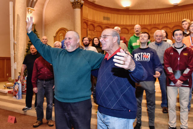 Joe Piskorik, of West Wyoming, left, will play Santa Claus, and Lou Volpetti, of Pittston, will play Rudolph, as the group sings 'Rudolph the Red-Nosed Reindeer.' Sean McKeag | For Times Leader