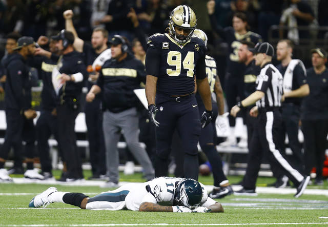 9734b636486 Philadelphia Eagles wide receiver Alshon Jeffery (17) lies on the turf in  front of