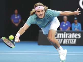 Federer, Kerber ousted in day of upsets at Australian Open