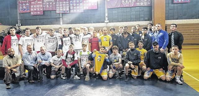 The Coughlin and Meyers wrestling teams get together for a photo after one final dual. The schools will merge with GAR next season to form the Wilkes-Barre Area Wolfpack. Dave Rosengrant | For Times Leader