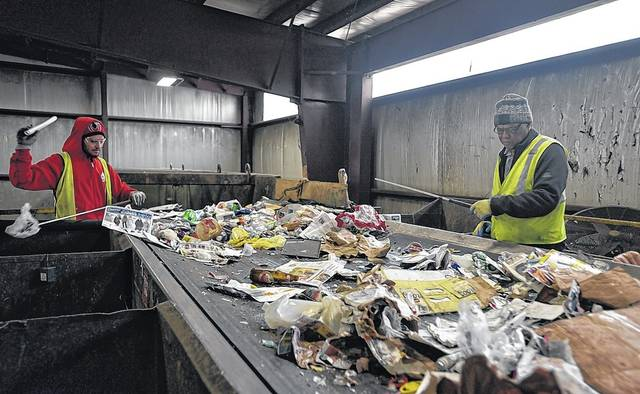The first sorters remove garbage from recycled items brought to Northeast Cartage in Hanover Township recently. Contaminated recycling and a lack of demand from China have made the recycling business much less profitable over the last few years. Aimee Dilger | Times Leader