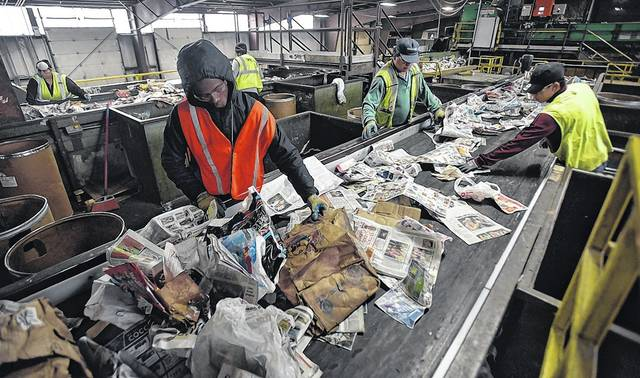 Cardboard is sorted from paper at Northeast Cartage in Hanover Township. Mixing garbage and non-recyclables with items that can be recycled can cause too much contamination in a load, meaning it cannot be sold. In instances such as that, the recycling can end up in a landfill, the very place it was supposed to avoid. Aimee Dilger | Times Leader