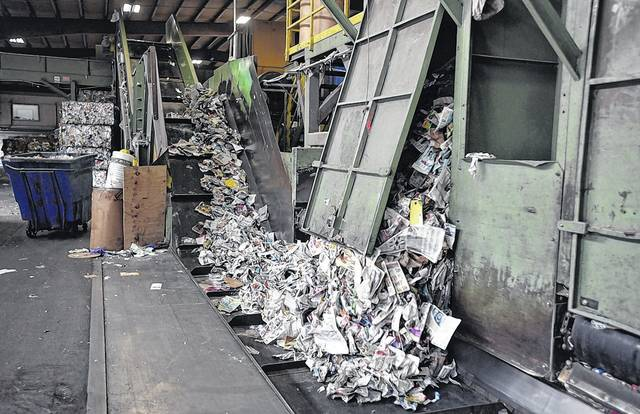 Once paper is sorted out from other recyclables, it is sent down a conveyor belt and sent for bundling at Northeast Cartage in Hanover Township. Aimee Dilger | Times Leader