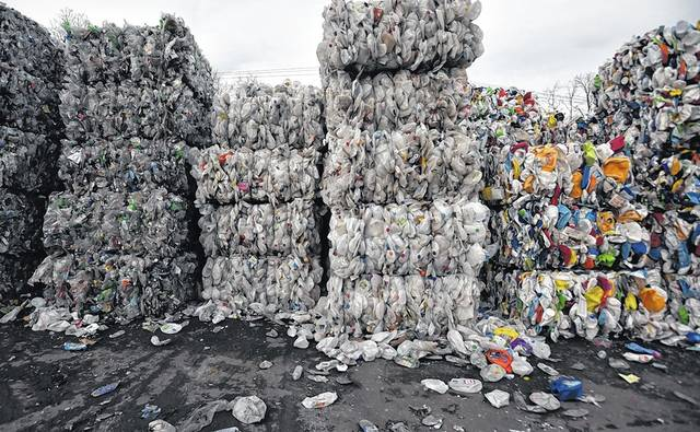 Bundled soda bottles, milk containers and thicker laundry containers are shown waiting to leave the recycling center at Northeast Cartage. Aimee Dilger | Times Leader