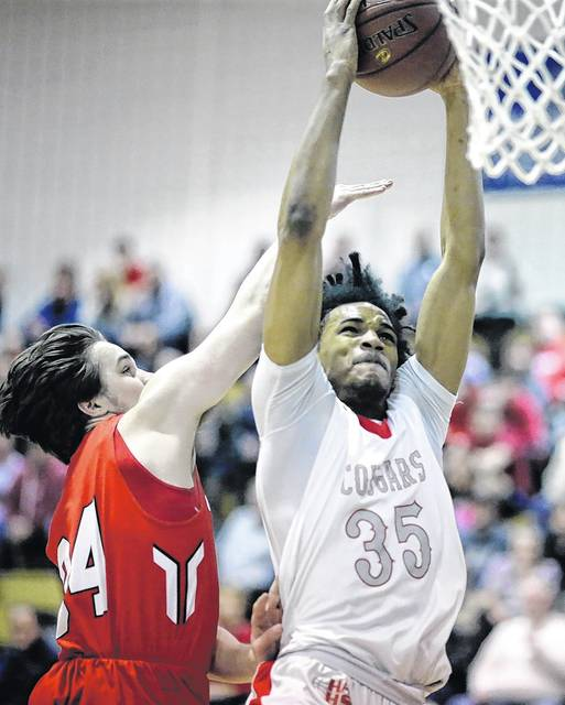 Hazleton Area's Da'Mir Faison goes in for a dunk ahead of Crestwood's Mike Palmiero in the WVC Division 1 boys basketball championship game at Berwick Middle School on Wednesday night. Bill Tarutis | For Times Leader