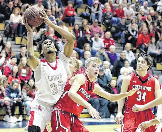 Hazleton Area's Da'Mir Faison puts back a rebound over Crestwood in the WVC Division 1 boys basketball championship game at Berwick Middle School on Wednesday night. Bill Tarutis | For Times Leader