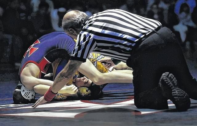Cooper Price got things going for Coughlin pinning Meyers' Kris Fronseca in just 38 seconds Wednesday at Coughlin High School in Wilkes-Barre. Fred Adams | For Times Leader