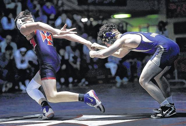 Coughlin's Jayden Pahler Coughlin escapes from Meyers' Jason Carver en route to a 3-0 decision Wednesday at Coughlin High School in Wilkes-Barre. Fred Adams | For Times Leader