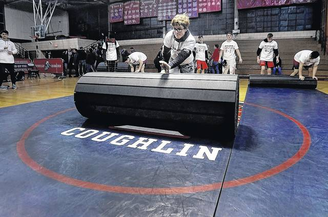 The Coughlin wrestling mat rolled up for the final time. Fred Adams | For Times Leader