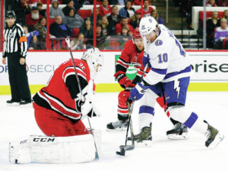 NHL: Lightning pull away late to beat Carolina