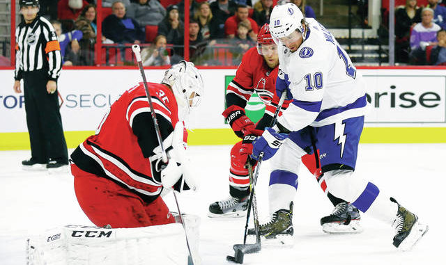 8c35460b960 NHL  Lightning pull away late to beat Carolina