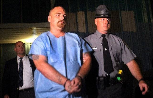 Daniel Elias Holtslander, 41, of Wilkes-Barre, is escorted by a state trooper during a prior court appearance. Just days before his trial was to begin, Holtslander pleaded guilty Thursday to third-degree murder and was sentenced to 15 to 30 years in state prison. Times Leader file photo