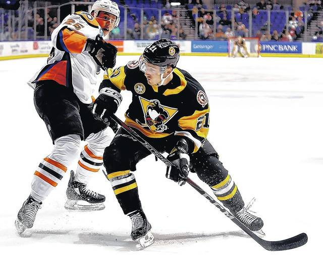 Wilkes-Barre Scranton Penguins Ryan Scarfo pushes past Lehigh Valley  Phantoms Connor Bunnaman during Wednesday s game at the Mohegan Sun Arena. 76a9a3823
