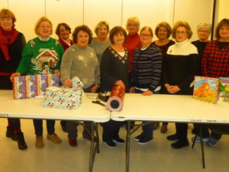 Women of the General Federation of Women's Club wrap gifts