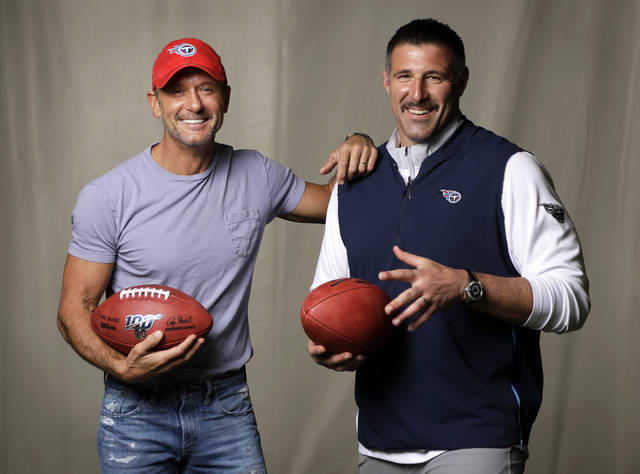 Country music star Tim McGraw, left, poses with Tennessee Titans head coach Mike Vrabel in Nashville, Tenn. After the second day of the of the NFL Draft in Nashville on Friday, McGraw will cap off the evening performing on the draft stage across the Cumberland River from Nissan Stadium, home of the Tennessee Titans. AP photo