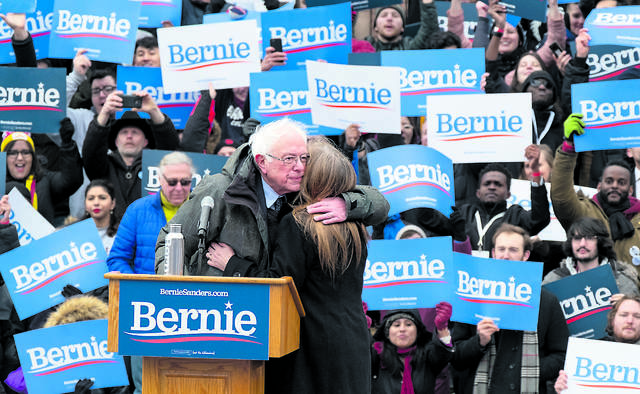 Sen. Bernie Sanders, I-Vt., hugs his wife Jane after he finished speaking at a March event in Brooklyn, N.Y. AP file photo