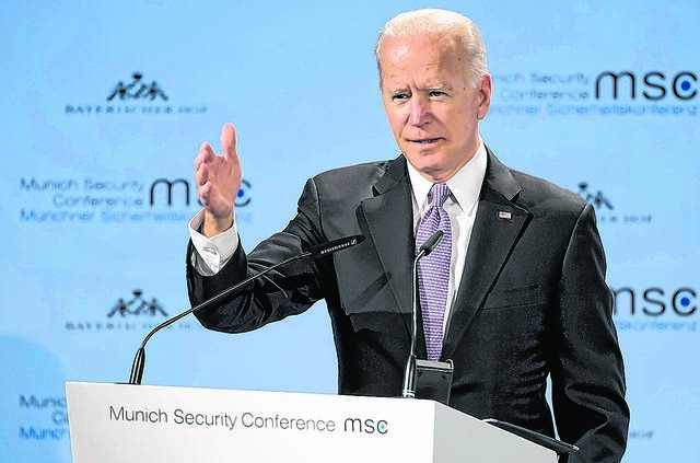 Former Vice President Joe Biden delivers a speech during the Munich Security Conference in February. Biden is now finalizing the framework for a White House campaign that would cast him as an extension of Barack Obama's presidency and political movement. AP file photo