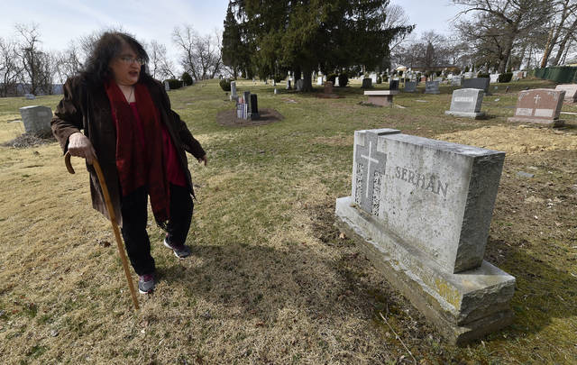 Sandra Serhan stands at the grave of her grandmother, Rita Serhan, in Saint Mary's Syrian Orthodox Cemetery. Rita Serhan was murdered 62 years ago on Stanton Street in Wilkes-Barre. The murder has not been solved. Aimee Dilger | Times Leader