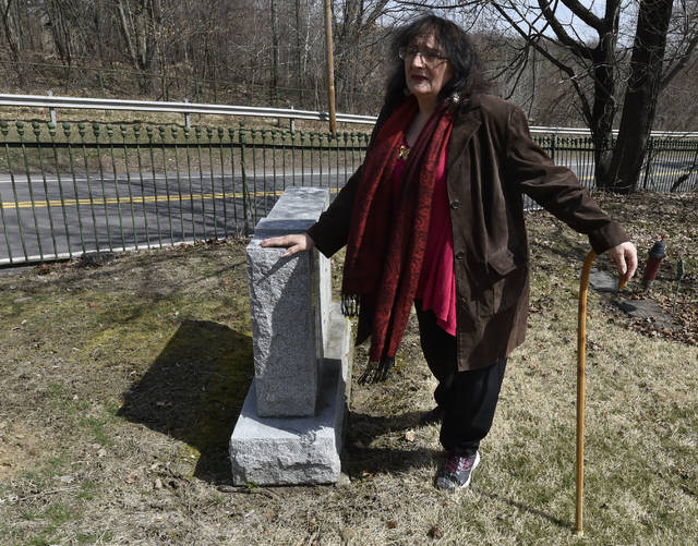Sandra Serhan visits the grave of her grandmother, Rita Serhan, who was brutally murdered 62 years ago on Stanton Street in Wilkes-Barre. Aimee Dilger | Times Leader