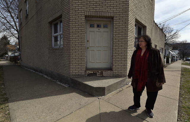 Sandra Serhan stands outside what once was her grandmother Rita Serhan's store and home at Loomis and Stanton streets in Wilkes-Barre. Rita Serhan's murder inside the building 62 years ago today remains unsolved. Aimee Dilger | Times Leader