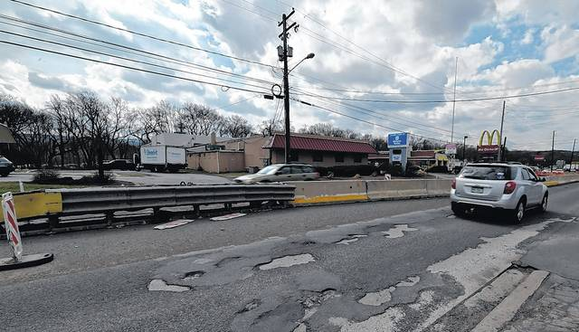 As anyone who travels the Sans Souci Parkway knows, the road surface is riddled with potholes and the remains of prior paving and patching jobs. Aimee Dilger   Times Leader