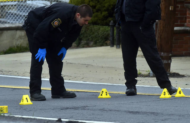 State troopers investigate the scene of an early morning shooting Wednesday on Casey Avenue in Wilkes-Barre Township. Two people were shot and taken to the hospital. Aimee Dilger | Times Leader