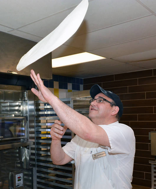 Frank Varvaglione, a Metz employee, has 38 years of experience making hand-tossed pizzas. Tony Callaio | For Times Leader
