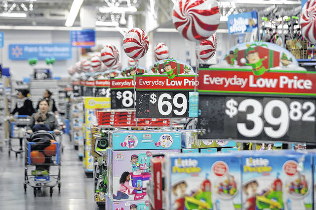 Prices in the toy section at Walmart in Teterboro, N.J. Analysts say big box giants like Walmart and Target, which have had strong performances, are best positioned to absorb the higher costs because of their clout with suppliers. AP photo