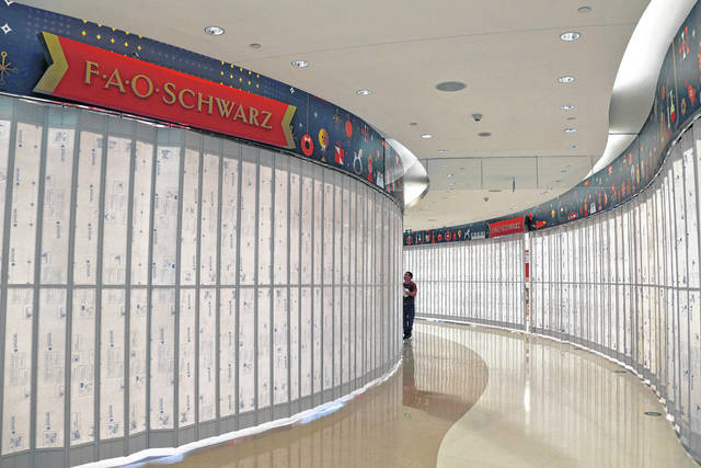 A worker checks on the new upcoming FAO Schwarz toy store at the capital city's popular shopping mall in Beijing. AP photo