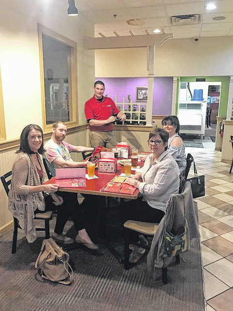 Servers at Grotto Pizza, Edwardsville, are seen being treated to dinner and served by managers as the restaurant celebrated National Waitstaff Day recently. Standing is manager Marc Reichert. Seated front to back on left: Amanda Loucks (16 years) and Roarke Tracy (9 years); front to back on right: Patty Kashmar (8 years) and Diane Luzny (23 years).
