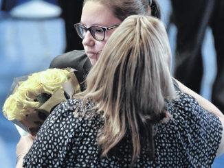 Good Shepherd Academy's speller Alyssa Evans receives a prayerful send-off