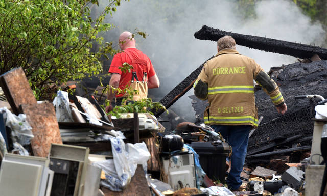 Dorrance Township Fire Chief Duane Seltzer enters the scene of a home explosion in the township Friday.