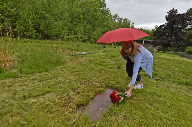 Woman wants remains of WWII vet stepfather moved from troubled cemetery