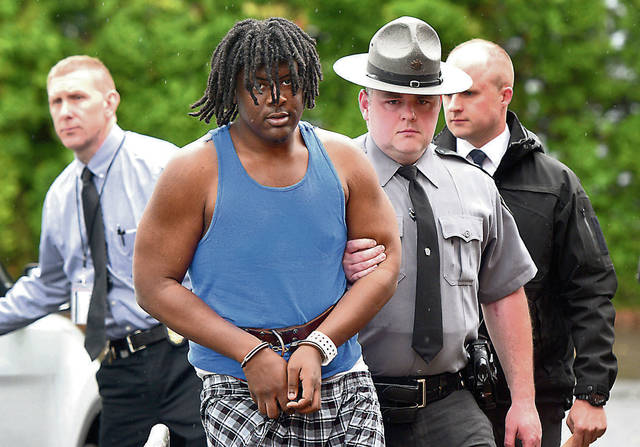 Homicide suspect Devin Malik Cunningham is escorted into district court on Tuesday to face homicide charges in connection with the april slaying of Joseph Monka, 71, in Edwardsville. Aimee Dilger | Times Leader