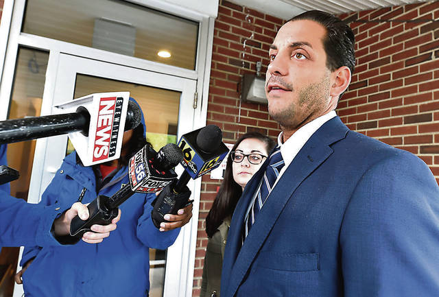 Assistant District Attorney Jarrett Ferrentino speaks with the media following Devin Malik Cunningham's arraignment on Tuesday. Aimee Dilger | Times Leader