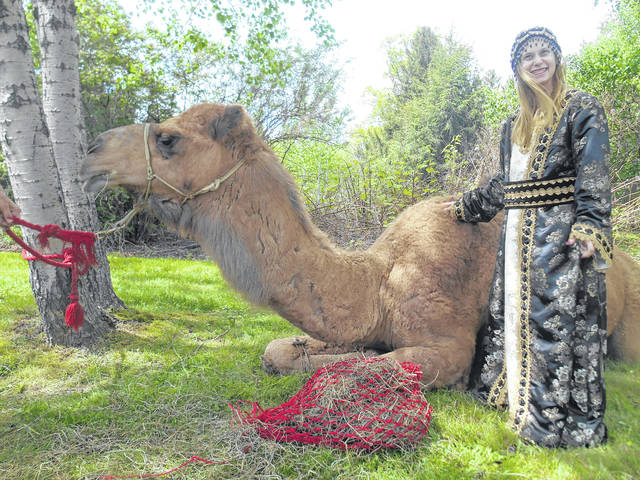 Humphrey the Camel visits Kadima residents in Drums