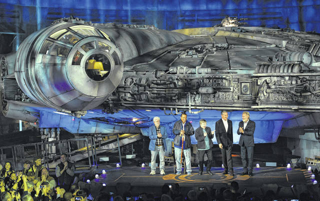 "From left, ""Star Wars"" film franchise creator George Lucas, cast members Billy Dee Williams and Mark Hamill, Walt Disney Co. Chairman and CEO Bob Iger and cast member Harrison Ford stand in front of the Millennium Falcon starship during a dedication ceremony for the new Star Wars: Galaxy's Edge attraction at Disneyland Park last week in Anaheim, Calif. AP photo"