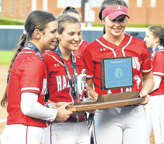 Hazleton Area's Julia Mrochko, Aleah Kost and Marissa Trivelpiece (from left) pose with the state runner-up trophy.  Tony Callaio | For Times Leader