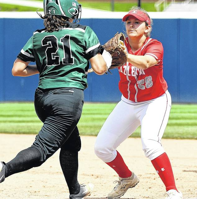 Hazleton Area's Kaitlynn Peters (28) tags Central Dauphin's Alondra Figueroa (21) out at first. Tony Callaio | For Times Leader