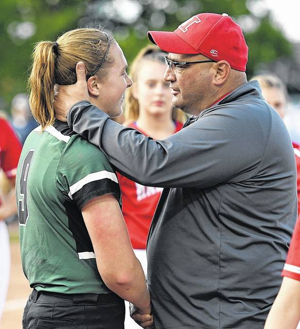 Hazleton Area head coach Bob Bertoni congratulates Central Dauphin's winning pitcher, Samantha Gress, after Thursday's state championship game. Tony Callaio | For Times Leader