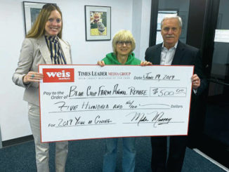 TL presents check to Blue Chip Farm