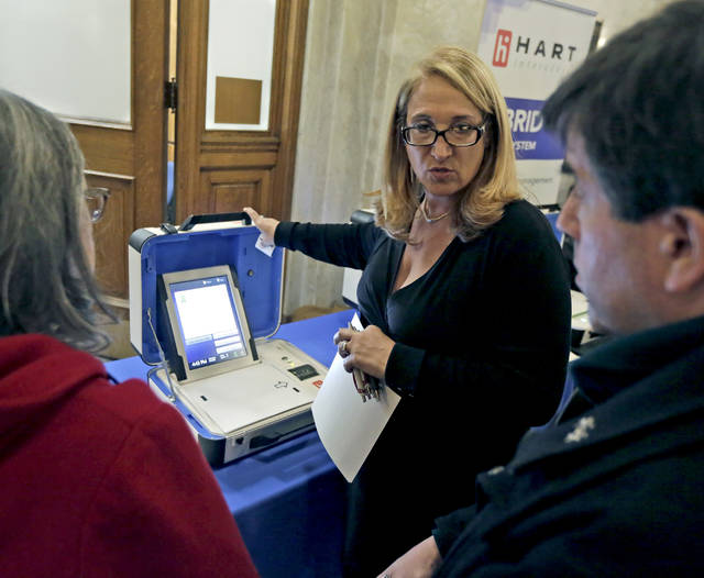 This paper-trail voting system, shown at a public expo at the Luzerne County Courthouse in February, is among several now under review by a county committee that will be recommending a system for purchase. File photo